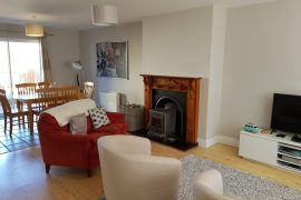 Lounge area with comfy sofas and log stove plus SKY TV and free WIFI!